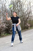 Fit woman playing badminton — ストック写真