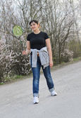 Woman standing with a badminton racket — Stok fotoğraf