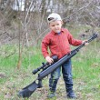 Little boy with a rifle — Stock Photo