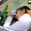 Alcoholic woman drinking a driving — Stock Photo #31969197
