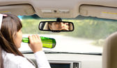 Woman driver drink driving — Stock Photo