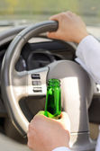 Woman drinking while driving — Stock Photo