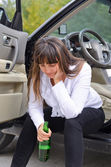 Alcoholic woman driver stopping for a drink — Stock Photo