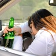 Stock Photo: Drunk woman driver passed out in the car