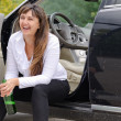 Happy woman drunkard in a car — Stock Photo
