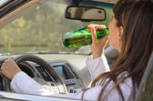 Woman drinking alcohol and driving — Stock Photo