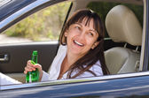 Drunk woman driving — Stock Photo