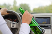 Alcoholic female driving a car — Stock Photo