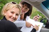 Proud successful woman purchasing a car — Stock Photo