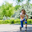 Teenage girl limbering up before skating — Stock Photo