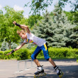 Stock Photo: Teenage girl roller blading in skate park