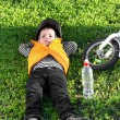 Small boy taking a rest on the grass — Stock Photo