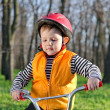 Little boy playing with his bicycle — Stock Photo