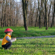 Little boy playing outdoors in woodland — Stock Photo #33054587