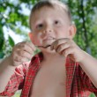Stock Photo: Little boy with earthworm in his hands