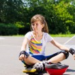 Young girl relaxing with her skating gear — Stock Photo