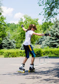 Young girl skating on rollerblades — Stock Photo
