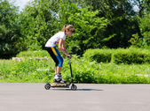 Teenage girl having fun on a scooter — Stock Photo