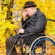 Stock Photo: Despondent despairing senior amputee
