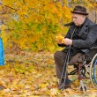 Foto Stock: Young boy with his handicapped grandfather