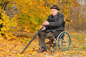 Elderly disabled man in his wheelchair — Stock Photo