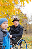 Disabled grandfather and grandchild — Stock Photo