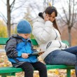 Young mother with her son in the park — Stock Photo #34163191