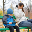 Young mother with her son in the park — Stock Photo