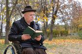 Handicapped elderly man in a wheelchair — Stock Photo