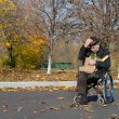 Lonely handicapped man in a wheelchair — Stock Photo