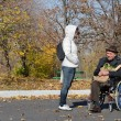Handicapped senior man in a wheelchair outdoors — Stock Photo
