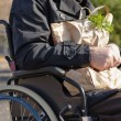 Stock Photo: Clouse up handicapped mdoing his grocery shopping