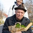 Stock Photo: Smiling senior mwith bag of groceries