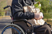 Clouse up handicapped man doing his grocery shopping — Stock Photo