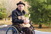 Handicapped man doing his grocery shopping — Stock Photo