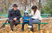 Young boy with his mother and grandfather — Stock Photo