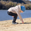 Small boy drawing in the beach sand — Stock Photo