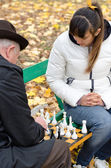 Senior man planning his next chess move — Stock Photo