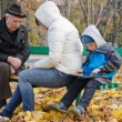 Family spending an autumn day in the park — Stock Photo