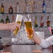 Two men toasting each other with their beers — Stockfoto #35585205