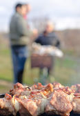 Meat grilling over an open fire in a BBQ — Stock Photo