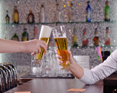 Two men toasting each other with their beers — Stock Photo