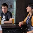 Barman socialising with customers at the bar — Foto de Stock