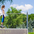 Teenage girl in rollerblades on a ramp — Stock Photo