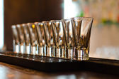 Row of empty glasses on a bar counter — Stock Photo