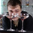 Barman working behind the bar counter — Stock Photo