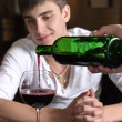 Barman or waiter pouring red wine — Stock Photo #36008011
