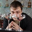 Man checking out three glasses of cocktail — Stock Photo