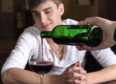 Barman or waiter pouring red wine — Stock Photo