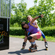 Two rollerbladers practising at the skate park — Stock Photo
